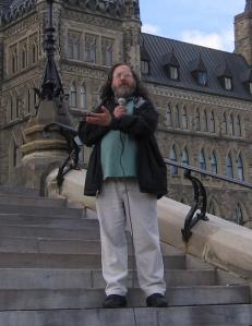 Richard Stallman on the steps of Parliament Hill, Ottawa, Canada